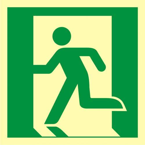 AAE001 - Wyjście ewakuacyjne (lewostronne) - znak ewakuacyjny - Stara czy nowa norma? Jakie znaki bezpieczeństwa wybrać?