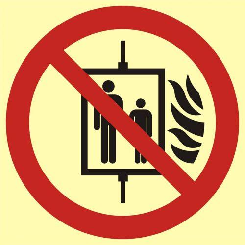 Nie używać dźwigu w przypadku pożaru - znak przeciwpożarowy ppoż - BB023 - Drogi pożarowe – oznakowanie