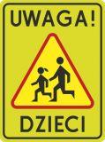 Znak A-17 T2 Uwaga! Dzieci - drogowy ostrzegawczy - Znak Agatka z lizakiem: co oznacza symbol dziewczynki na drodze i gdzie się go stawia?