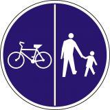 Znak C-13/16 - pionowo - Znak wskazujący ruch rowerów lewą stroną drogi i ruch pieszych prawą stroną drogi - drogowy nakazu - Ruch pieszych wzdłuż drogi
