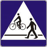 Znak D-6b Przejście dla pieszych i przejazd dla rowerzystów - drogowa tablica informacyjna - Urządzenia zabezpieczające ruch pieszych i rowerzystów