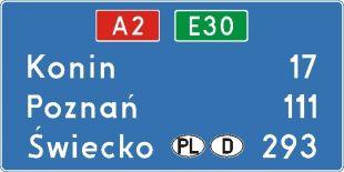 Znak E-14a Znak numeru drogi i odległości od miejscowości - drogowy kierunku miejscowości