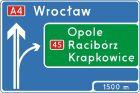 Znak E-1a Tablica przeddrogowskazowa na autostradzie - drogowy kierunku miejscowości