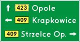 Znak E-2a Drogowskaz tablicowy umieszczany obok jezdni - drogowy kierunku miejscowości - Znaki drogowe kategorii E – ogólne zasady stosowania znaków kierunku i miejscowości