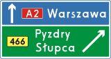 Znak E-2c Drogowskaz tablicowy umieszczany obok jezdni na autostradzie - drogowy kierunku miejscowości - Oznakowanie eksperymentalne dróg szybkiego ruchu