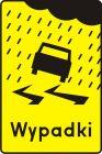 Tabliczka wskazująca miejsce częstych wypadków spowodowanych śliską nawierzchnią jezdni ze względu na opady deszczu